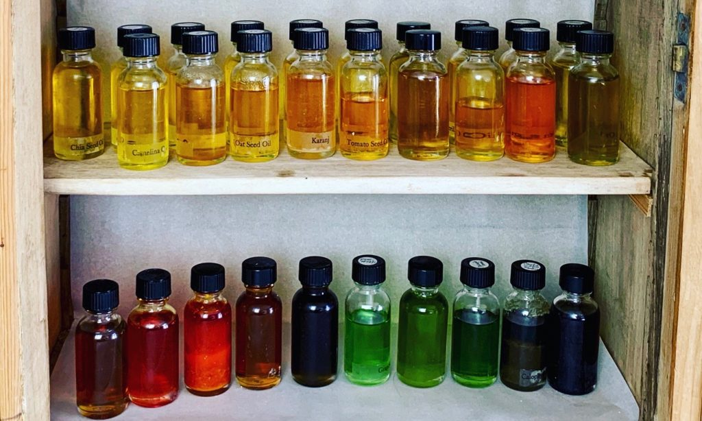 a selection of antioxidant rich oils in a range of colors displayed in a cupboard